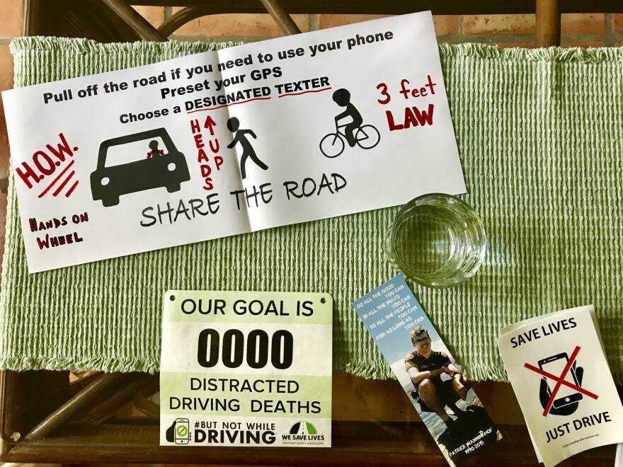 A banner, bookmarks and bumper stickers warning about the dangers of distracted driving on Debbie Wanninkhof's coffee table.