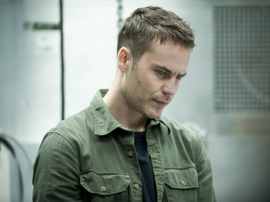 Taylor Kitsch, best known for his role as football star Tim Riggins on <em>Friday Night Lights</em>, plays detective Paul Woodrugh in the second season of <em>True Detective.</em>