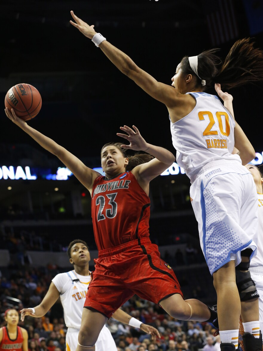 Louisville guard Shoni Schimmel (23) shoots in front of Tennessee center Isabelle Harrison (20) in the second half of the regional final in the NCAA women's college basketball tournament in Oklahoma City on Tuesday.