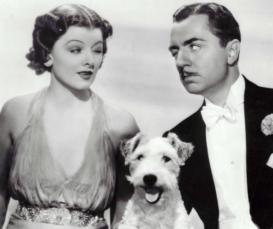 Myrna Loy and William Powell (and a wire-haired terrier) starred as Nick and Nora Charles (and Asta) in the 1934 film adaptation of Dashiell Hammett's <em>The Thin Man.</em>