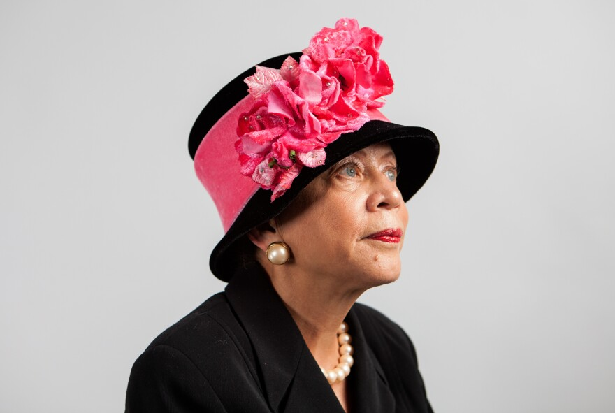 Donna Limerick, daughter of Mae Reeves, wears her favorite hat designed by her mother. The original is housed at the National Museum of African American History and Culture, so she wears a replica.