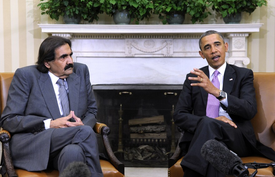 President Obama meets with the emir of Qatar, Sheik Hamad bin Khalifa Al Thani, in the Oval Office on Tuesday. The emir is among a series of visiting Middle East leaders urging the U.S. to take a greater role in the Syrian conflict.
