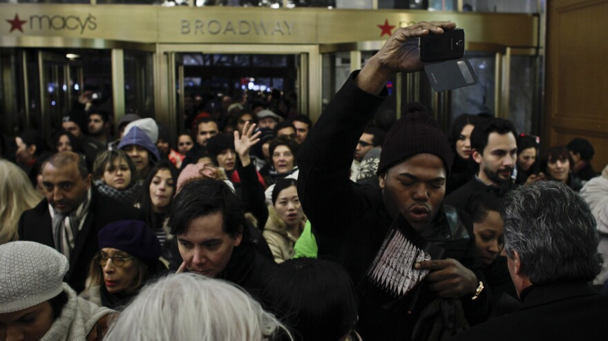 People enter Macy's Herald Square store after opening its doors at 8 p.m. on Thanksgiving Day in New York City.
