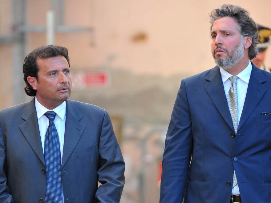 Francesco Schettino (left), the captain of the Costa Concordia, leaves court with  his lawyer, Francesco Pepe, last month. A judge has ordered Schettino to stand trial in the wreck of the cruise ship last year.