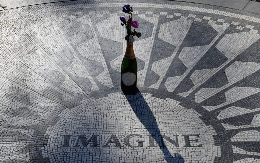 """A champagne bottle with flowers adorns the """"Imagine"""" mosaic at the Strawberry Fields Memorial for John Lennon, in Central Park in New York City."""