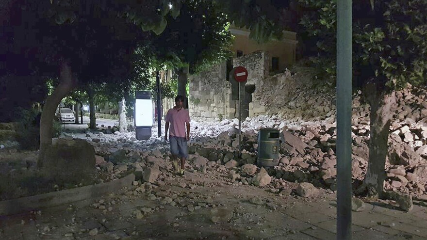 A man walks near a damaged building after an earthquake struck near the Greek island of Kos early Friday.