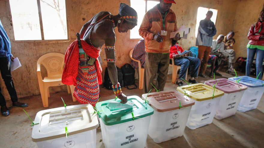 A Kenyan Samburu warrior casts his ballot at a polling station in Nkirish, in the Eastern Province, during general elections on Tuesday. Kenyans began voting in general elections headlined by a too-close-to-call battle between incumbent Uhuru Kenyatta and his rival Raila Odinga, sparking fears of violence in east Africa's richest economy.