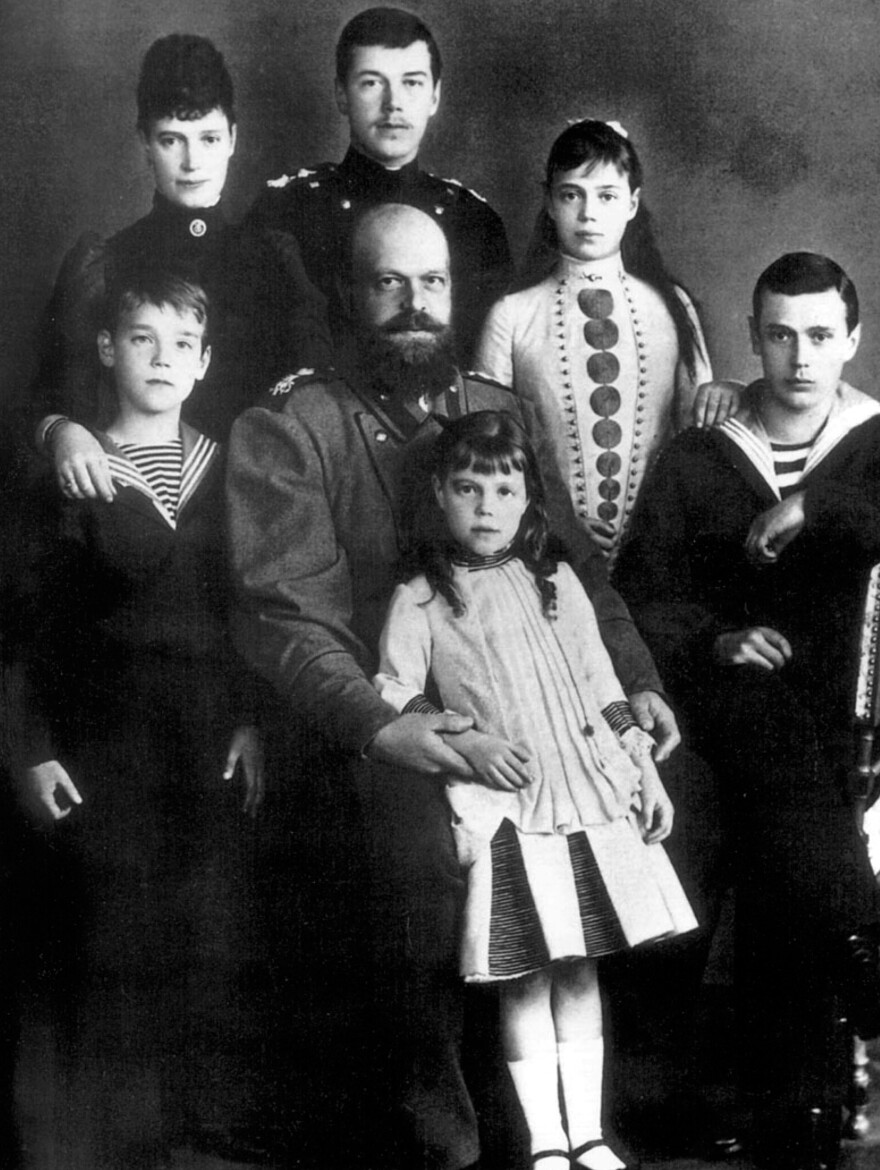 """Czar Alexander III and his wife, Maria Feodorovna, posed for a photo in about 1885 with their children, including Nicholas II, the future czar, standing in back. Alexander went by the title """"Emperor and Autocrat of All the Russias."""" His reign was conservative and repressive."""