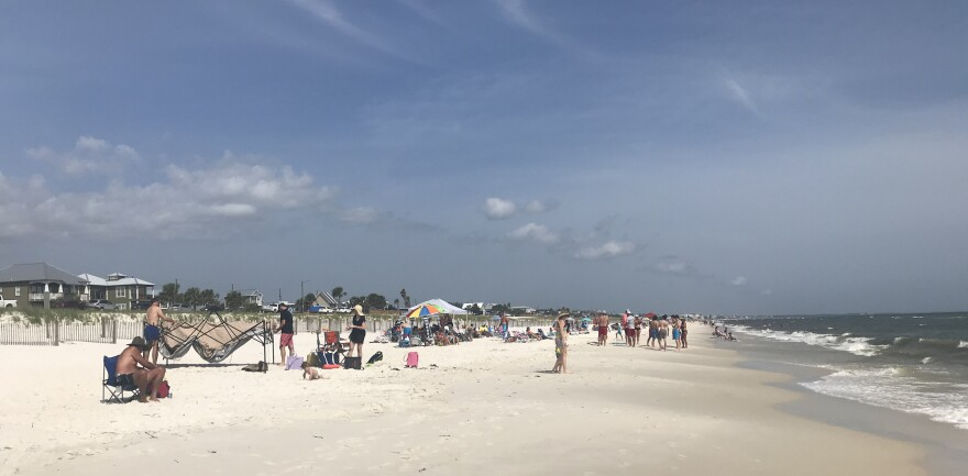 Families and friends enjoyed the warm Gulf waters and the sand on Saturday, May 23, 2020 in Mexico Beach, Florida.