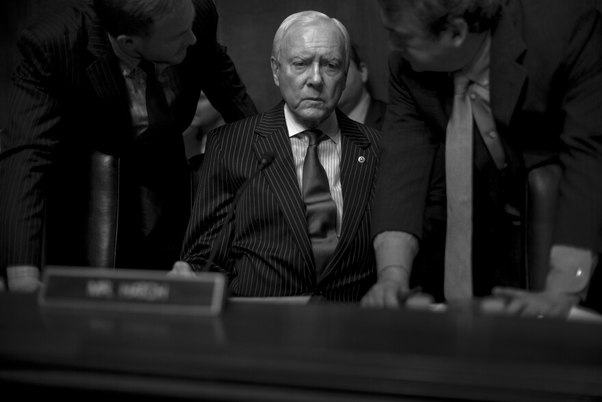 Sen. Orrin Hatch, R-Utah, speaks with his aides before the Senate Judiciary committee hearing to consider nomination of Rod Rosenstein to deputy Attorney General and Rachel L. Brand to associate Attorney General on March 7.
