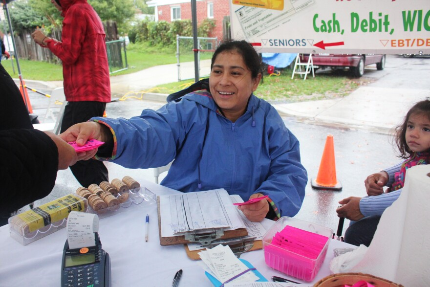 Rosie Sanchez handles SNAP transactions at Crossroads market. She also doubles the value of vouchers from the WIC (Women, Infants, and Children) program.