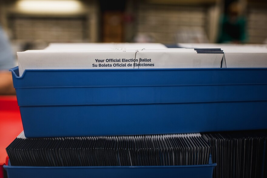 Ballot envelopes sit in a bin at the Voter Registration office. Election workers everywhere are doing what they can to adjust to court cases and changing rules around voting in Pennsylvania.