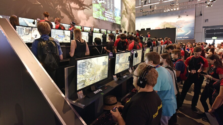 Participants play the latest video games at the gamescom computer game fair in Cologne, Germany, on Wednesday. The Electronic Sports League, which sponsors a tournament in the city later this month, says it will require random drug tests to ensure players are clean.