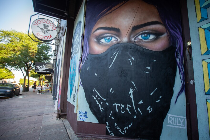Murals adorn closed businesses in downtown Austin during the coronavirus pandemic.