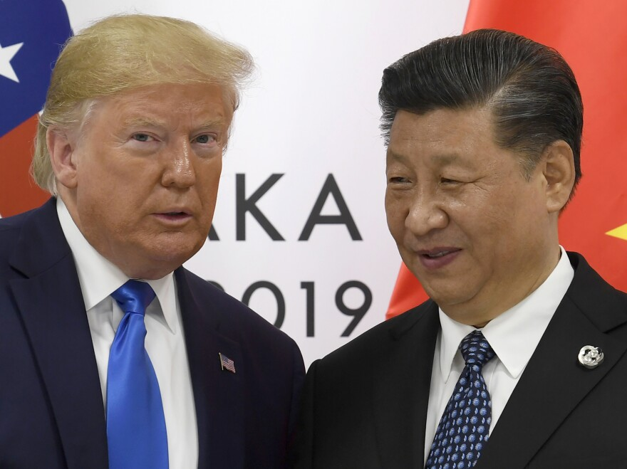President Trump poses for a photo with Chinese President Xi Jinping during a meeting on the sidelines of the G-20 summit in Osaka, Japan, on June 29, 2019. President-elect Joe Biden will find it hard to change the confrontational approach to China, although he's likely to set a more polite tone.