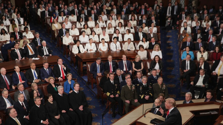 Female lawmakers dressed in white, in observation of the 100th anniversary of Congress voting to grant women the right to vote, watch as Trump delivers the State of the Union address.