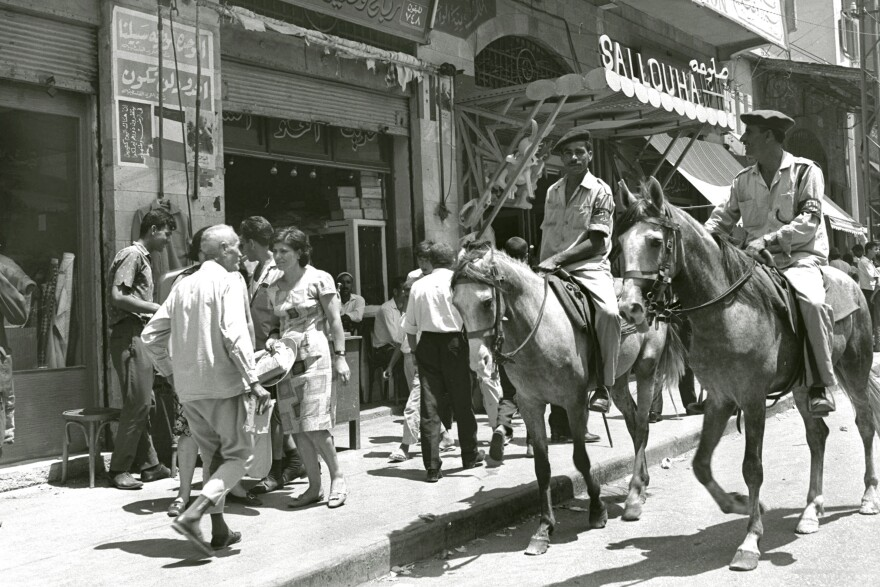 Palestinian mounted policemen patrol Gaza City's main street about two months after the 1967 Six-Day War.