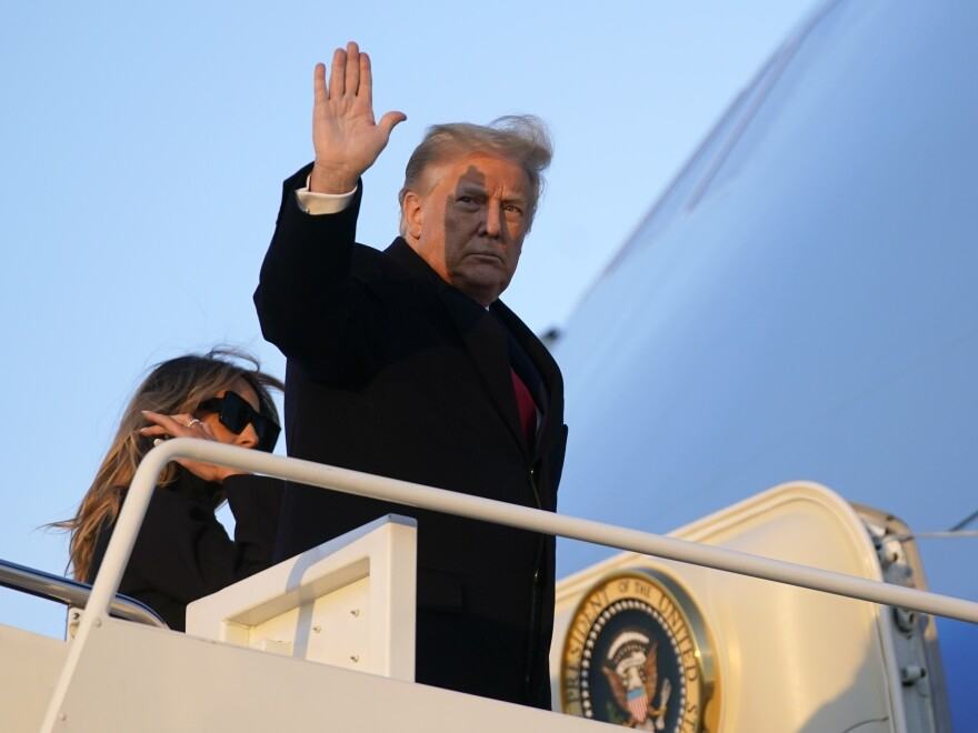 President Trump continues to withhold his signature from a coronavirus relief package that would extend jobless benefits for millions of Americans. Trump, who says the bill doesn't provide large enough payments for individuals, left for his Mar-a-Lago resort this week without signing the measure.
