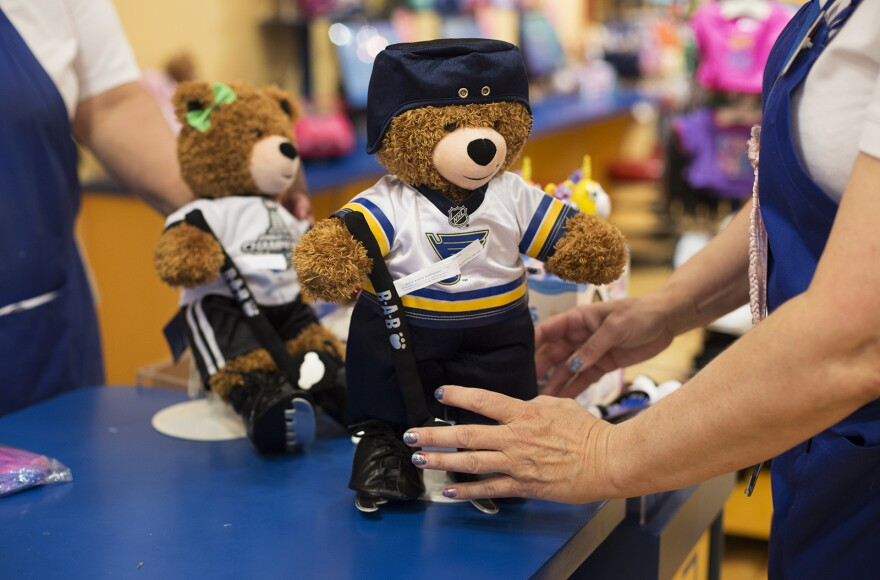 A Build-A-Bear employee sets out a display bear after dressing it in a new Blues uniform at at a store in the St. Louis Galleria. With the approval of a tax incentive package, the company is expected to move its headquarters to downtown St. Louis.