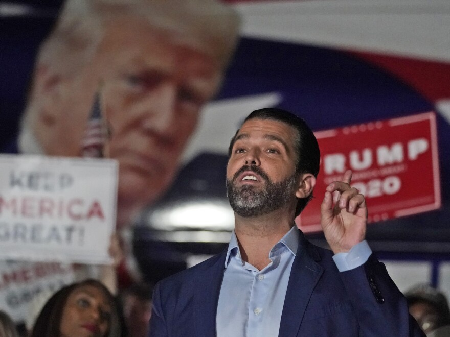 In this Nov. 5 photo, Donald Trump Jr. gestures during a news conference at Georgia Republican Party headquarters in Atlanta. Trump Jr. has been infected with the coronavirus, and says he is currently asymptomatic.