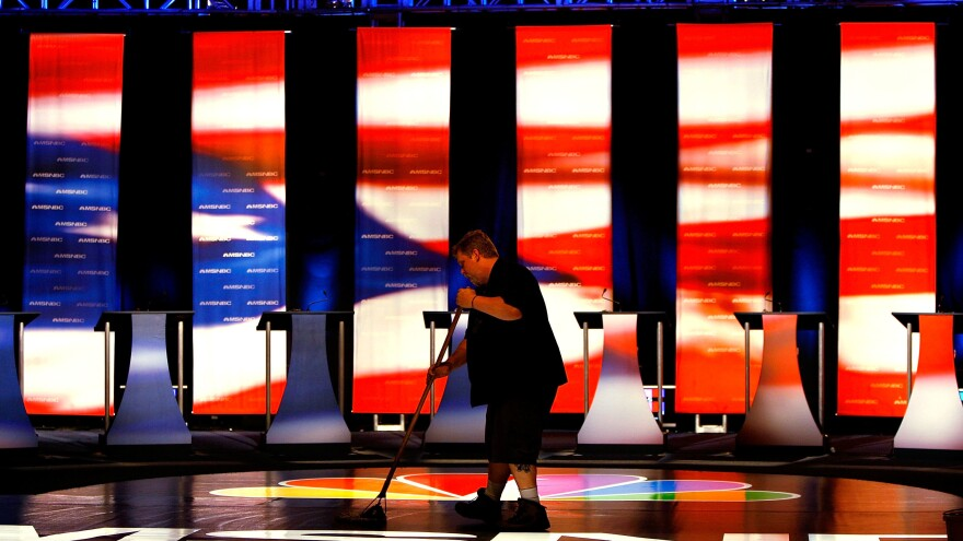 A worker sweeps the stage prior to the first Democratic presidential debate on April 26, 2007, in Orangeburg, S.C. The debate featured eight Democratic presidential candidates.