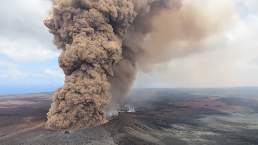 A column of thick, reddish-brown ash rises in the air on Friday, after a magnitude 6.9 earthquake shook Hawaii's Big Island.