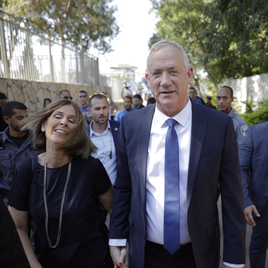 Blue and White party leader Benny Gantz and his wife, Revital, leave a polling station in Rosh Haayin, Israel, on Tuesday.