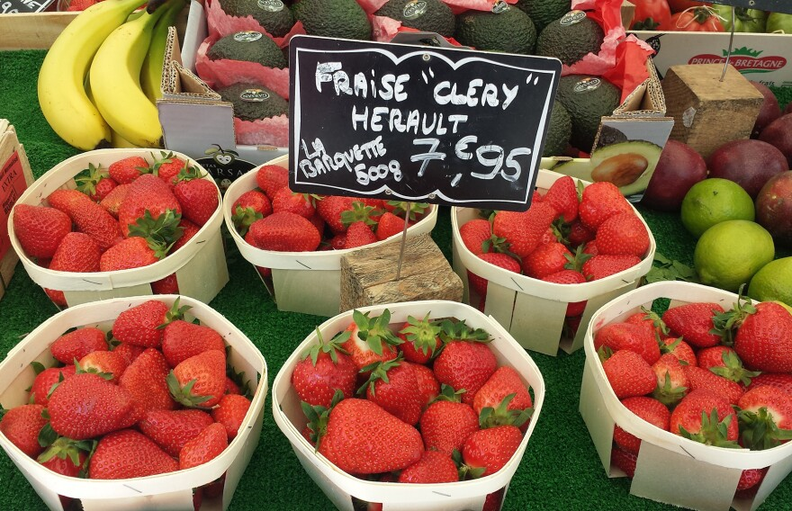 <em>Cléry</em> strawberries are on sale at a market in Paris. Strawberries take over the city's outdoor markets — and one woman's memory — in May.