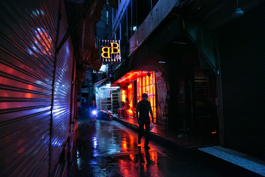 The relatively empty Patpong red-light district in Bangkok. In March and April, Thailand closed its borders and canceled commercial flights because of the global pandemic. The country's tourism industry — which is entwined with the sex worker industry — collapsed.