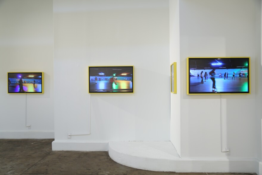 Installation view of Katherine Simone Reynolds' video work which depicts to young men moving through various physical spaces in St. Louis