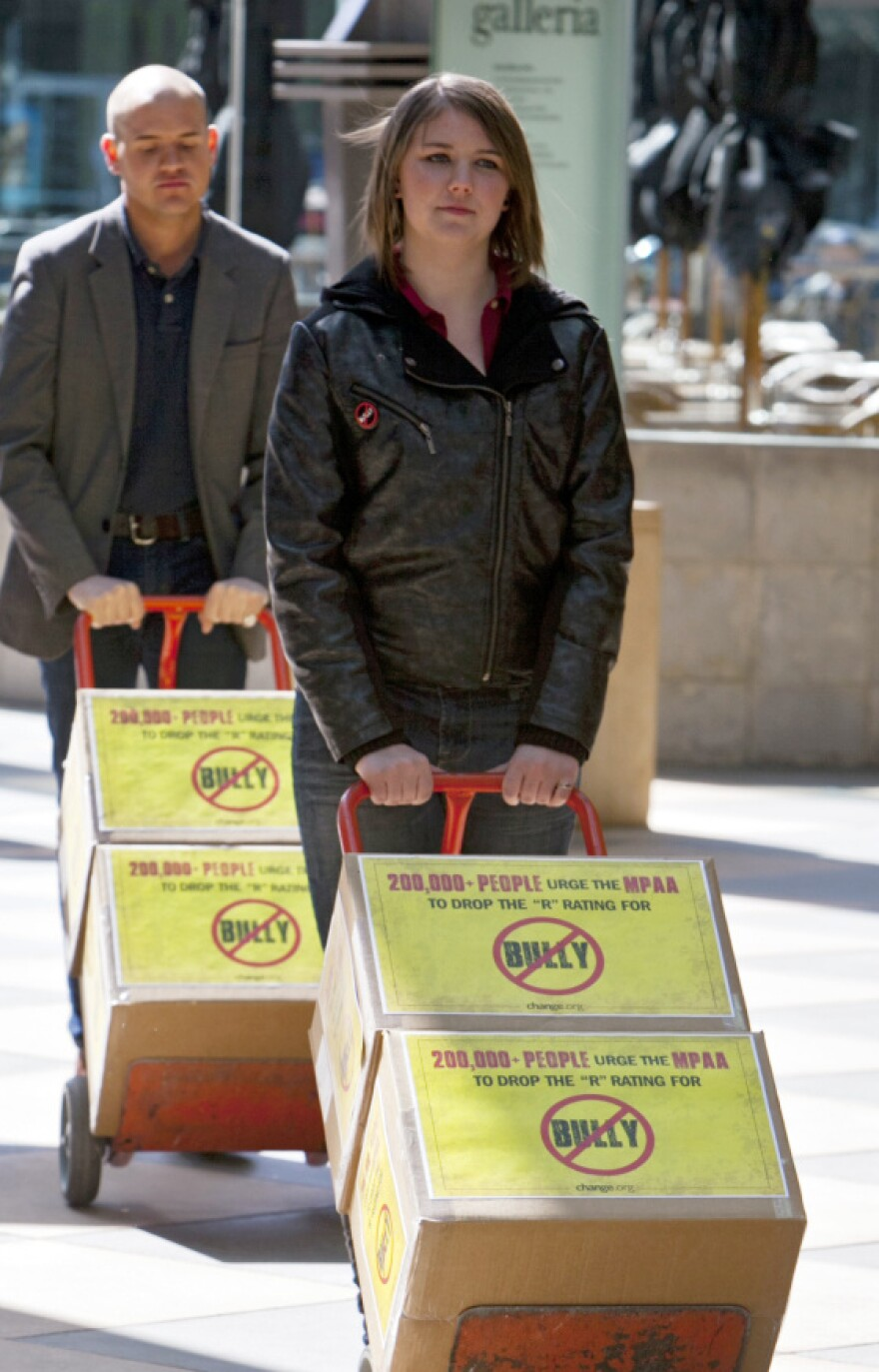Michigan high school student Katy Butler, 17, and Change.org organizer Mark Anthony Dingbaum deliver petitions with more than 200,000 signatures to the Motion Picture Association of America in Los Angeles on March 7, asking the group to change the R rating on the documentary <em>Bully</em>.