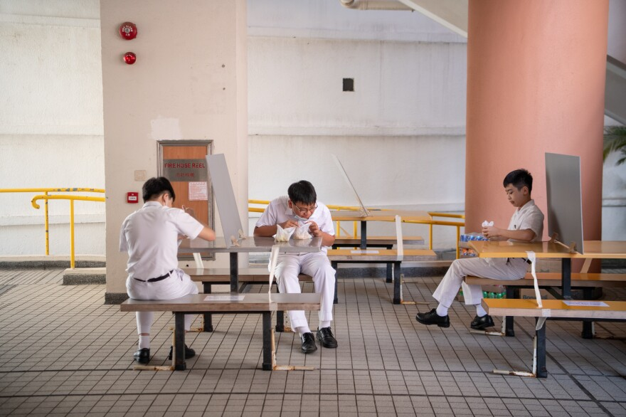 For snack time, tables are socially distanced — and some have dividers.