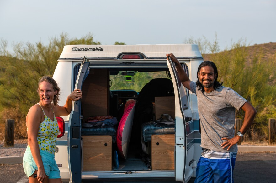 "At the Salt River, Rachel and Prashan Srinivasan show off the interior of their ""pandemic purchase"", a 1990s van with a pop-up top and room for sleeping. They bought the van to have a COVID-safe space to travel around in."