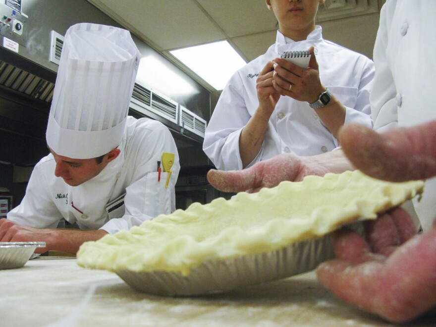 Would-be chefs take notes as CIA Instructor George Higgins demonstrates perfect pie crust.