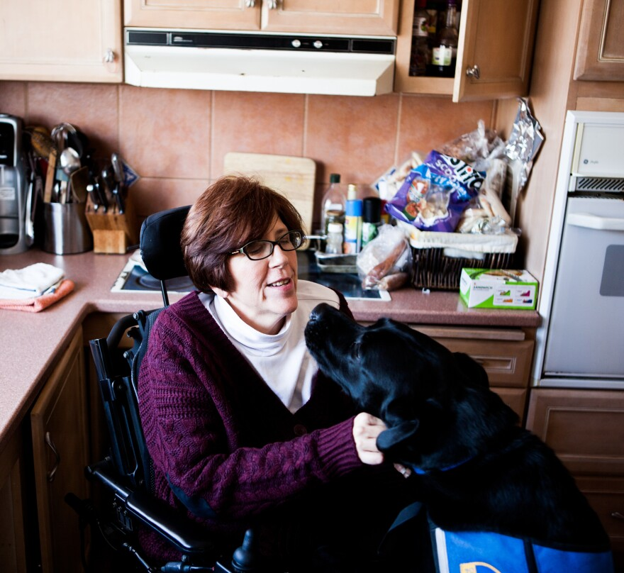 Treston with her service dog, Finn, at her home.