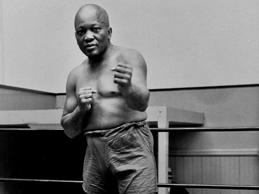 Jack Johnson, seen here in New York City in 1932, was the first black world heavyweight champion. On Thursday, President Trump granted him a rare posthumous pardon, clearing his name more than a century after a racially charged conviction.