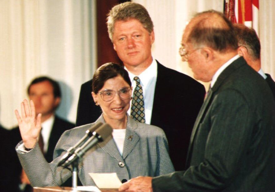Chief Justice of the U.S. Supreme Court William Rehnquist administers the oath of office to newly appointed Supreme Court Justice Ruth Bader Ginsburg with President Bill Clinton on Aug. 10, 1993.