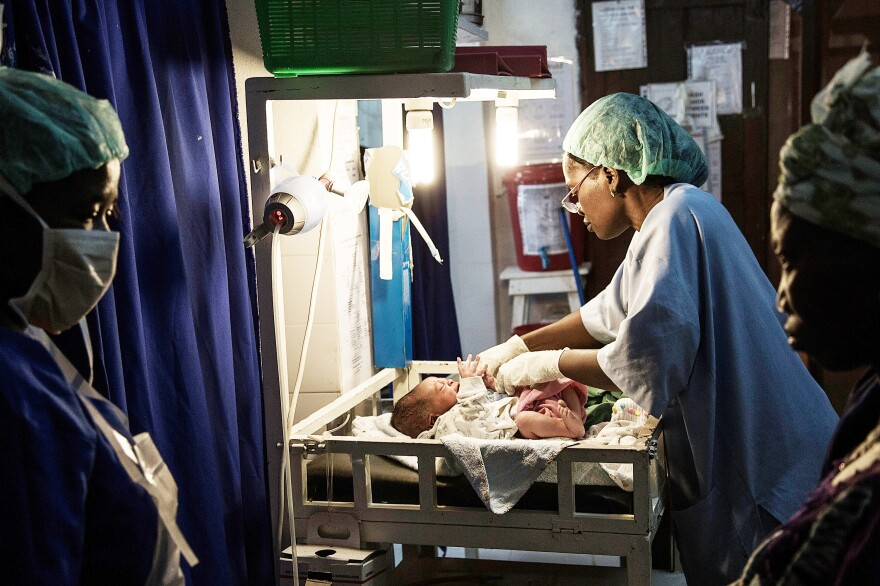 A newborn in Sierra Leone is treated after delivery by Caesarean section. The country's child mortality rate has dropped from 264 per 1,000 in 1990 to an estimated 120 this year.
