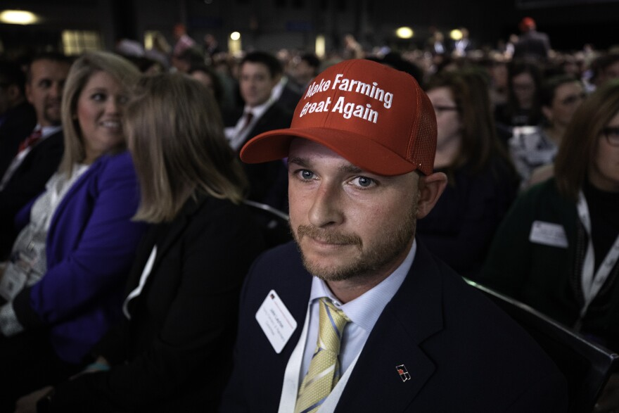 "John Layton wears a hat that says ""Make Farming Great Again."""