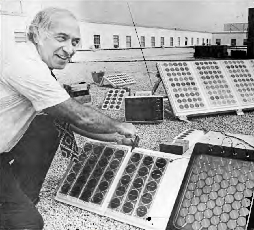 Elliot Berman tests solar arrays on the roof of Solar Power Corp.'s offices.