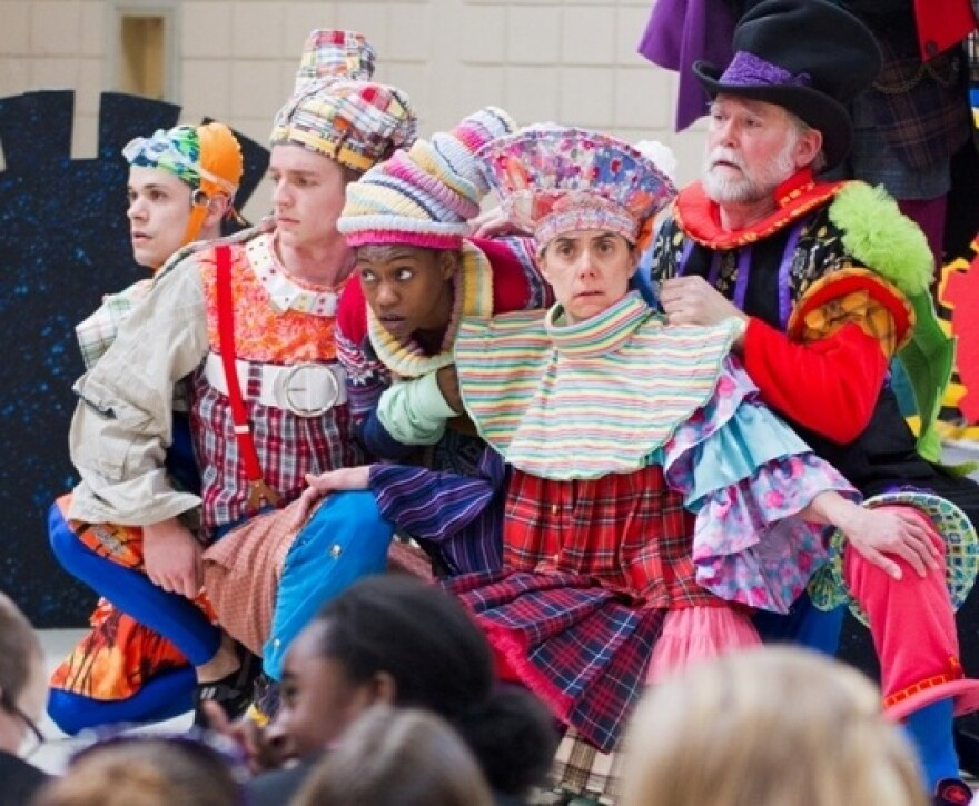 scene from the play of oddly costumed actors