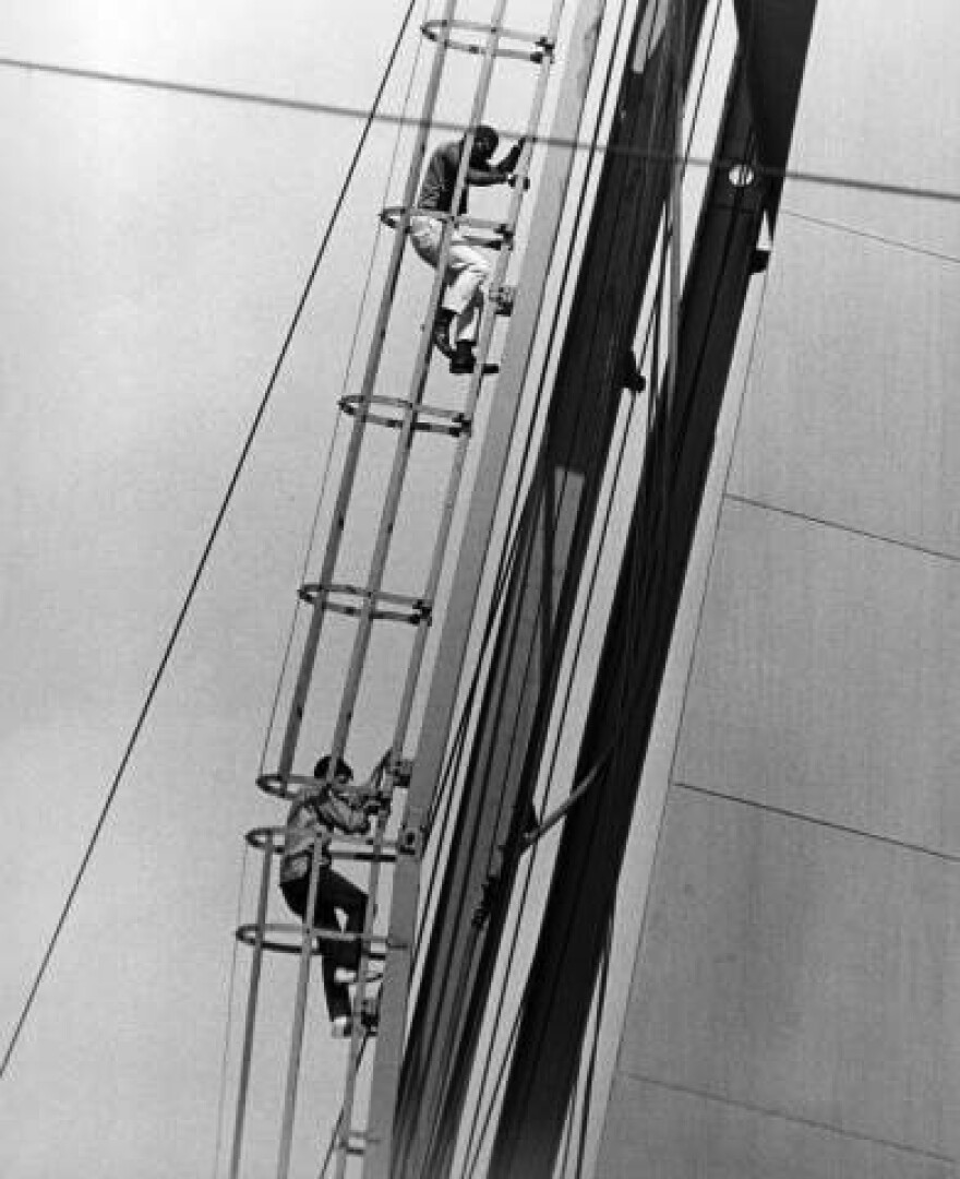 July 14, 1964: CORE demonstrators Percy Green (top) and Richard Daly on the Arch.