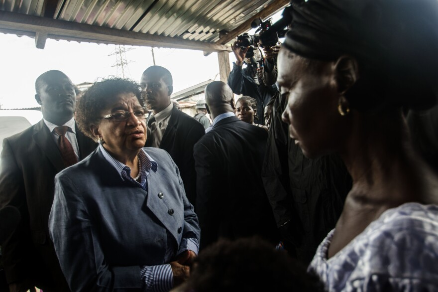 President Ellen Johnson Sirleaf apologizes to Eva Nah, the aunt of the teenager who was shot by Liberian security forces last week and later died.