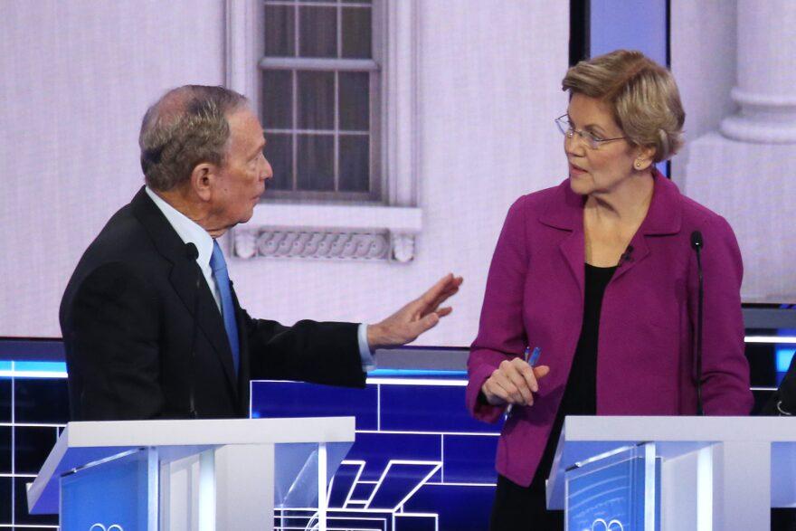 Democratic presidential candidates former New York City Mayor Mike Bloomberg and Sen. Elizabeth Warren (D-MA) speak during the Democratic presidential primary debate in Las Vegas, Nevada.