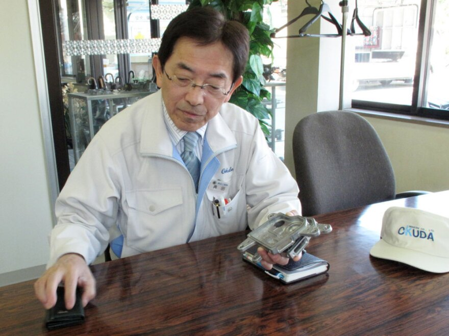 """""""In order to make a car, all the parts have to be available,"""" Okuda Industries President Kiyohito Okuda says. """"We can be at full production here, but if plants in other areas are shut down and parts are missing, you can't make a car."""""""