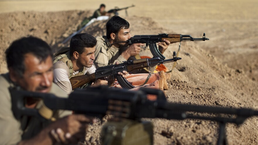 Iraqi Kurdish peshmerga fighters hold a position on the front line in the Gwer district, 25 miles south of Irbil, the capital of the Kurdish region, on Sept. 15. Aided by U.S. airstrikes, the Kurds have been able to retake some positions from the Islamic State.