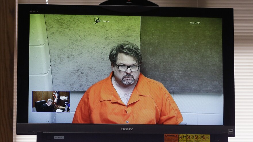 Jason Dalton is arraigned via video Monday before Judge Christopher T. Haenicke in Kalamazoo, Mich. Dalton is charged with multiple counts of murder in a series of random shootings in western Michigan.
