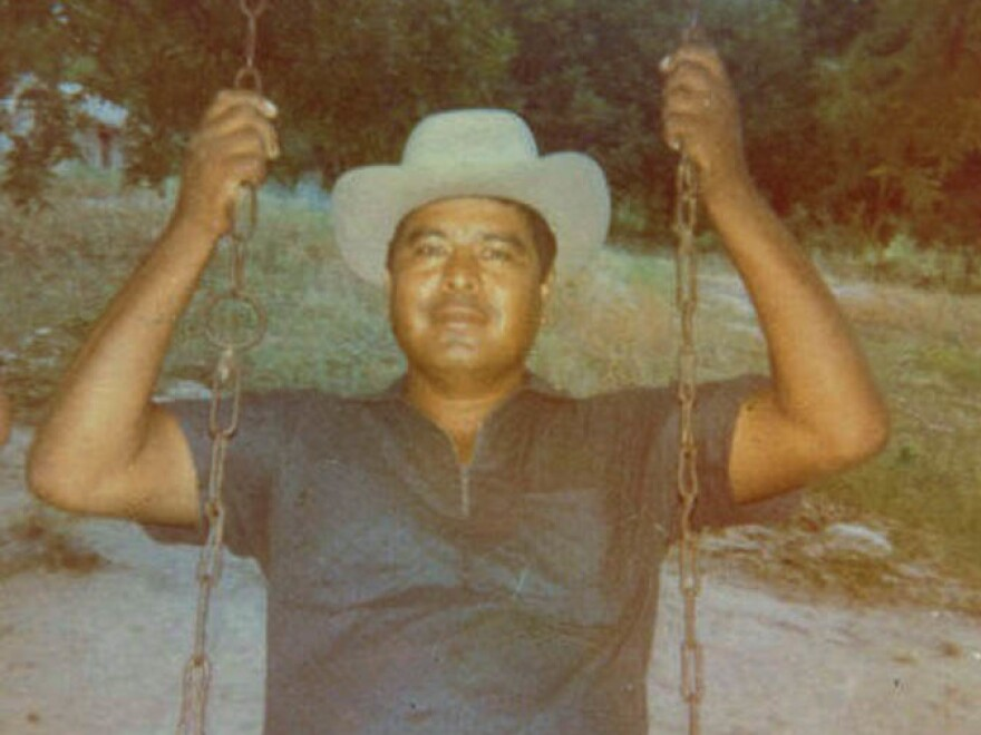 Juan Reyes sits on a swing in the early 1970s.