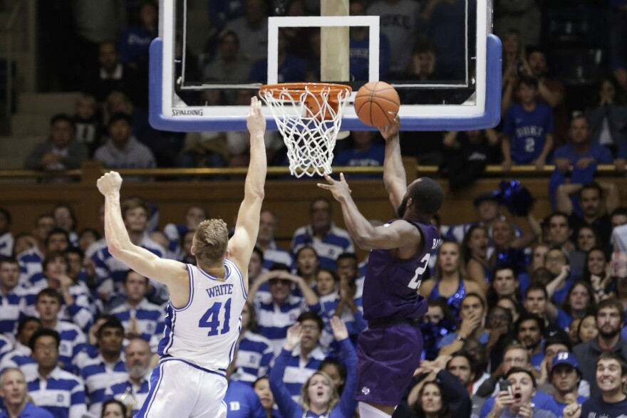 Stephen F. Austin forward Nathan Bain (23) drives for a game winning basket over Duke forward Jack White (41) during overtime in an NCAA college basketball game in Durham, N.C., Nov. 26.