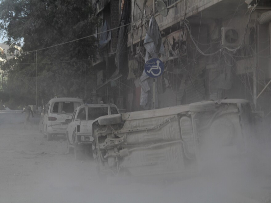 Smoke rises after a reported barrel bomb attack by Syrian government forces in the northern Syrian city of Aleppo on Wednesday.
